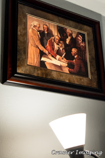 Cramer Imaging's photograph example of fine art hung on the wall and illuminated by a nearby light source