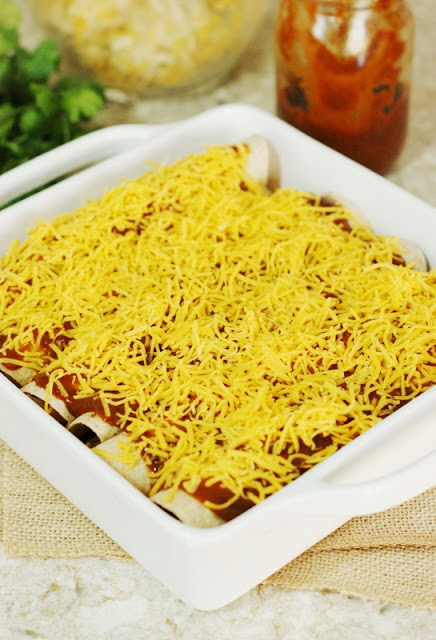 """Simple Chicken Enchiladas ~ Chicken & cheese filling seasoned simply for just the right flavor """"oomph"""" & moistness.  Make a pan for tonight, and one to freeze for later!   www.thekitchenismyplayground.com"""