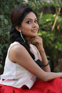 Actress Mahima Nambiar Latest Stills in White Top and Red Skirt at Kuttram 23 Movie Press Meet  0025.jpg