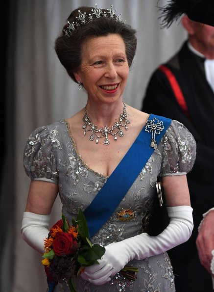 Queen Letizia wore a Navy blue gown, Diamond necklace, diamond earrings, diamon tiara. Princess Anne tiara and necklace, and wore lace dress