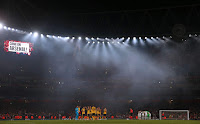 Floodlights inside Arsenal's Emirates Stadium in London. (Photographer Credit: Adrian Dennis/AFP via Getty Images) Click to Enlarge.