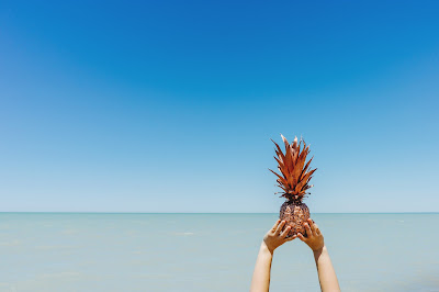image of the beach and a pineapple