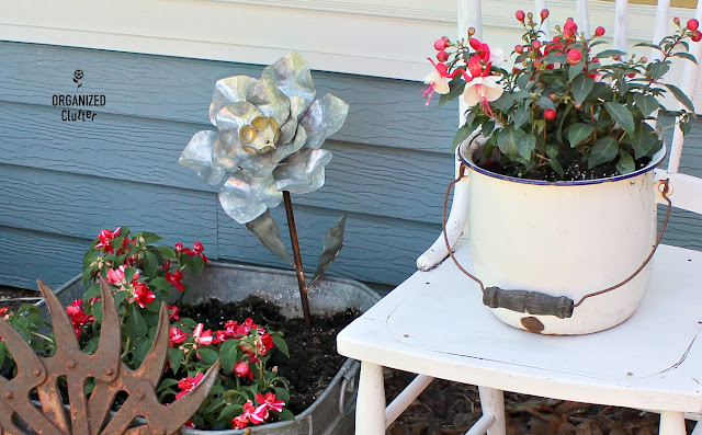 Junk Garden Chair Vignette #cultivatorwheel #gardenchair #galvanizedflower #shadegarden