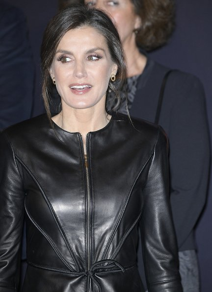 Queen Letizia wore a leather peplum jacket by EmporIio Armani and a black crepe wide-leg trousers by Carolina Herrera