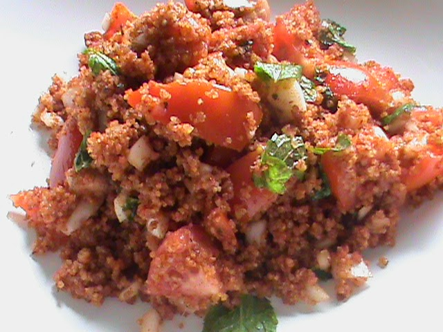 In a large bowl add the bulgur wheat and the tomato paste and mix together by rubbing wel Bulgur Wheat Salad (Kamouneh) recipe
