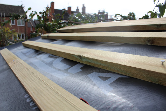 roof battens on top of roofing felt on shed