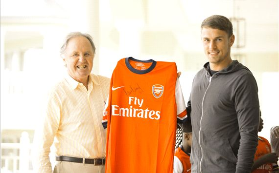 2a2a70491 Dicky Evans (L) of Hemingways Collection receives a signed Arsenal jersey  from Aaron Ramsey.