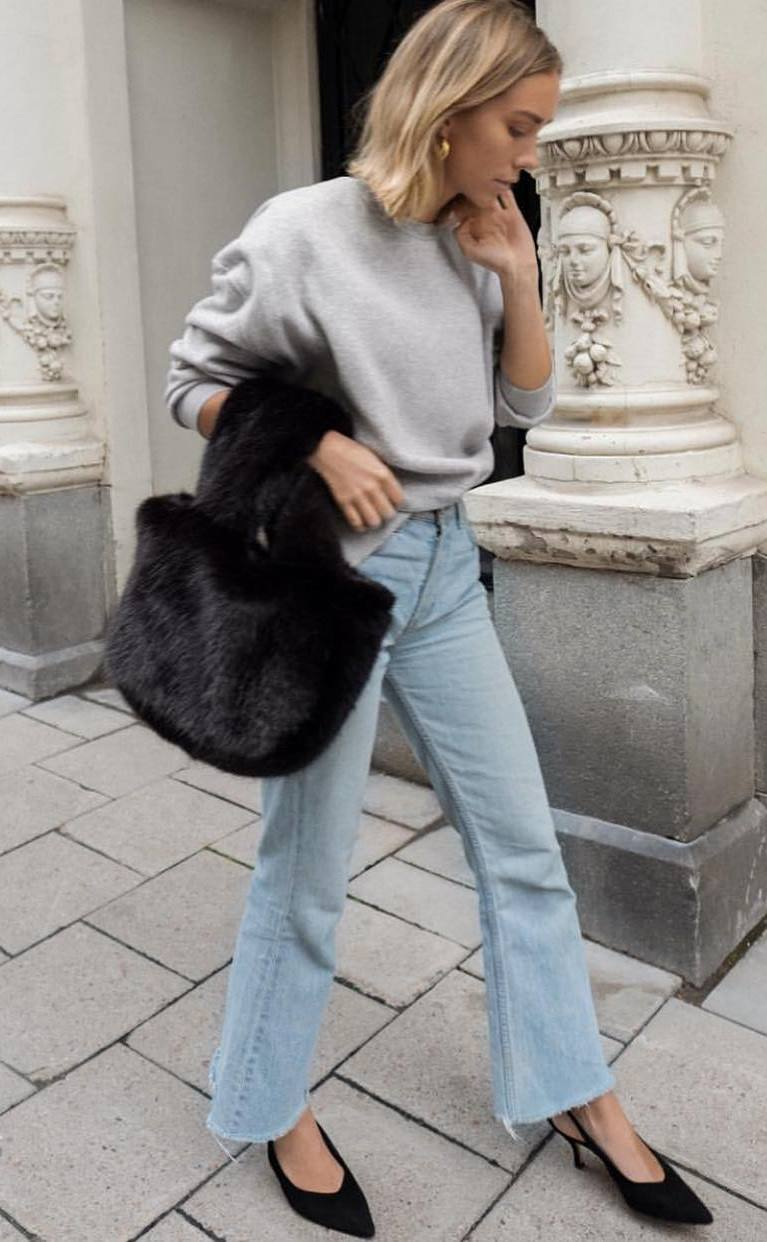 what to wear with a fur bag : grey sweater + jeans + heels