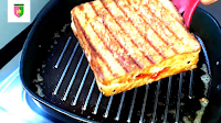 image of flipping sandwich on pan