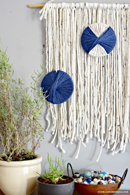 DIY boho wall hanging with navy blue accents