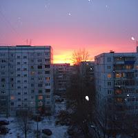 закат из окна городской квартиры