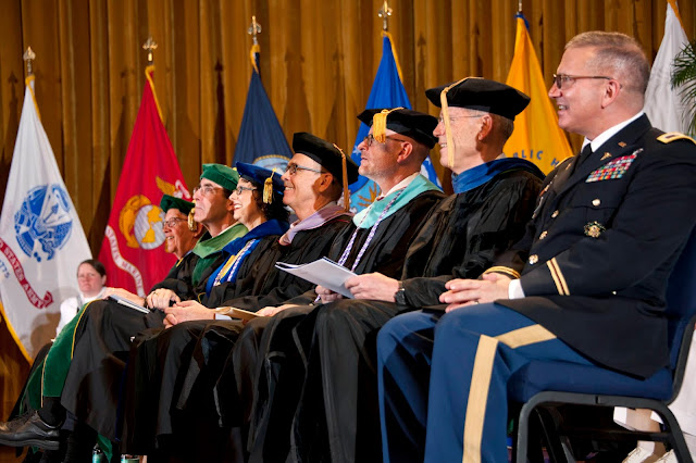 The deans and other officials on stage at graduation