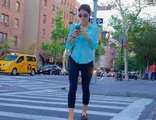 People using their phones and walking