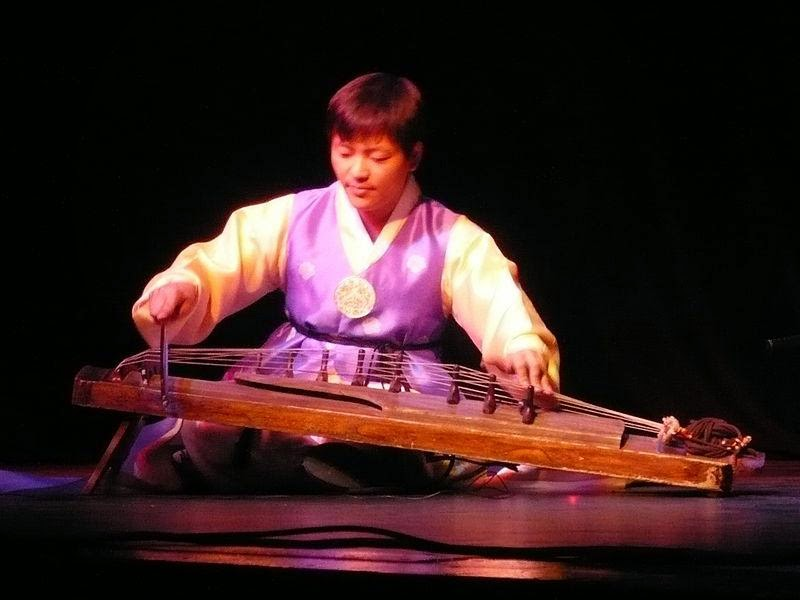 Hyeon-Sik Shin from Ensemble Sinawi playing the ajaeng