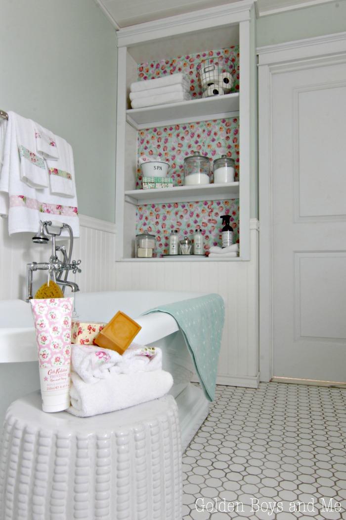 Floral drawer liner used as bookshelf wallpaper in DIY bathroom - www.goldenboysandme.com