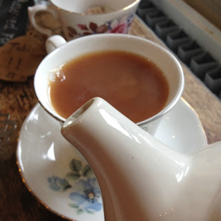 tea pot spout and cup of tea