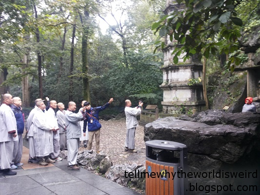 group of monks looking at a tower