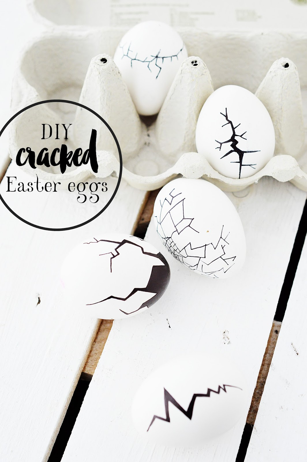 cracks painted onto a bunch  of Easter eggs using a marker