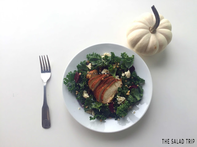 white table with a small white pumpkin, fork and plate of Kale's got the Beets Salad