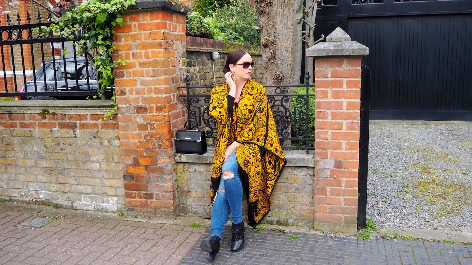 mustard and black kimono with paisley print and fringe