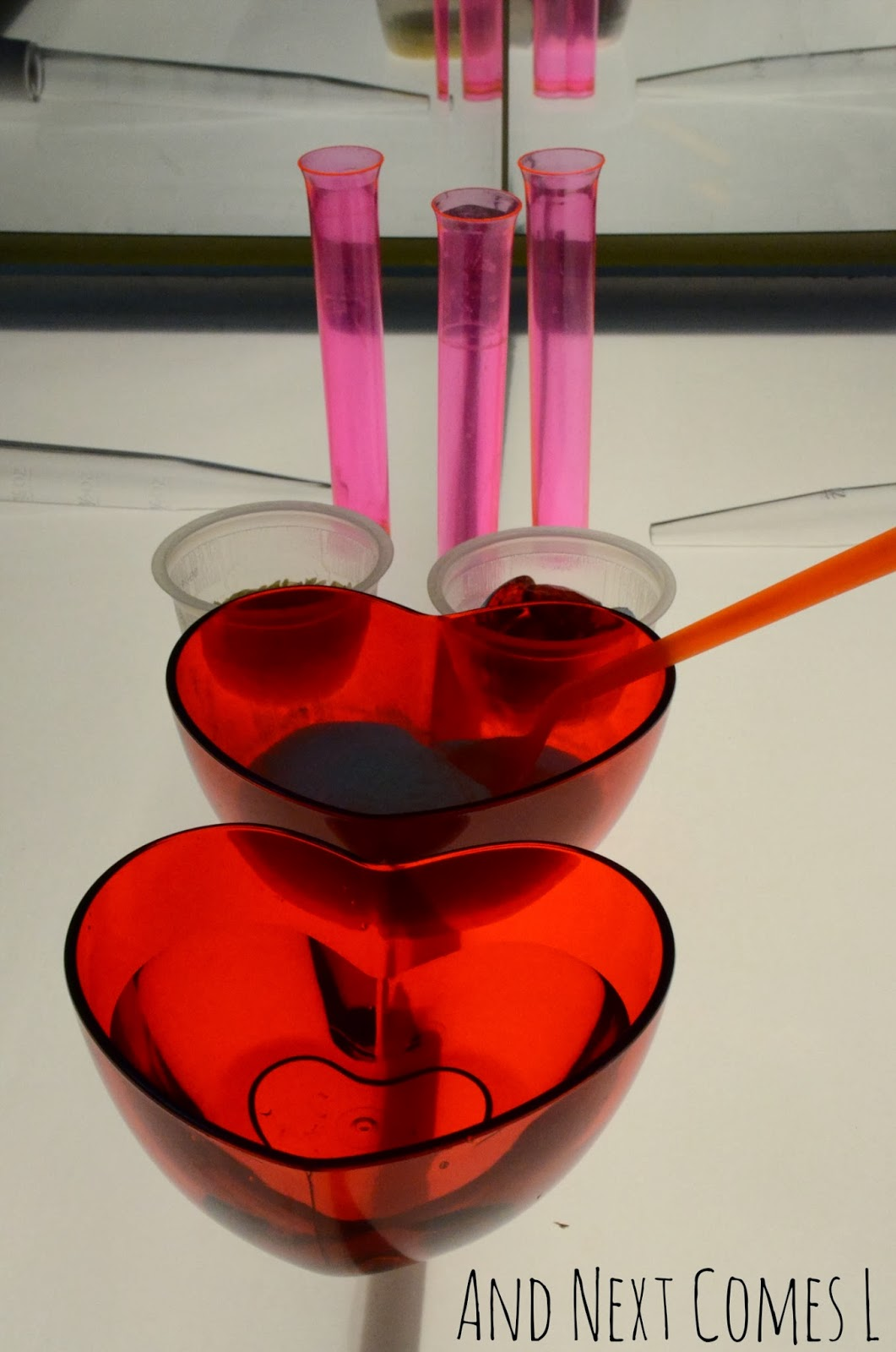 Invitation to create love potions on the light table - a simple Valentine's science activity for kids from And Next Comes L
