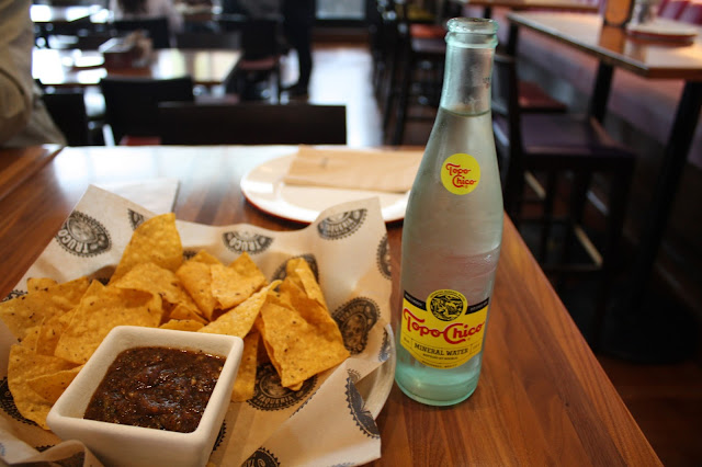 Fresh chips and salsa and Topo Chico at Truco