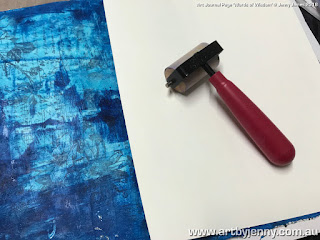 painting a background using acrylic paint and collage tissue paper