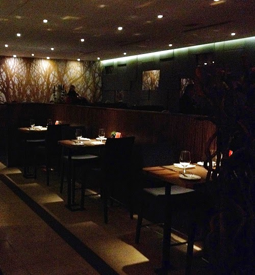 a dark room with booths