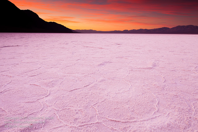 a photo of the sunrise on the badwater salt flats in death valley