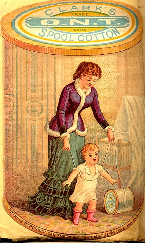 Woman wearing purple coat trimmed in white over green dress plays with child