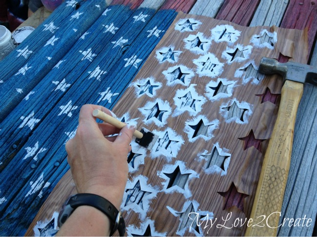Stenciling on the stars to the American Flag