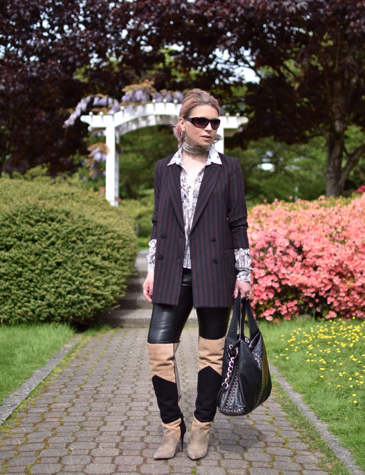 Monika Faulkner outfit inspiration - styling over-the-knee boots with a slouchy suit jacket and vegan leather leggings