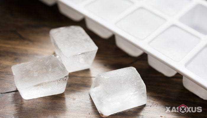Cara menghilangkan sakit kepala dengan es batu