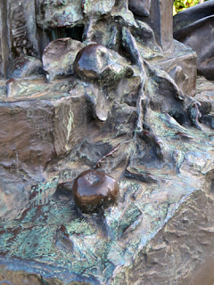 bronze apples, detail from sculpture of cider press
