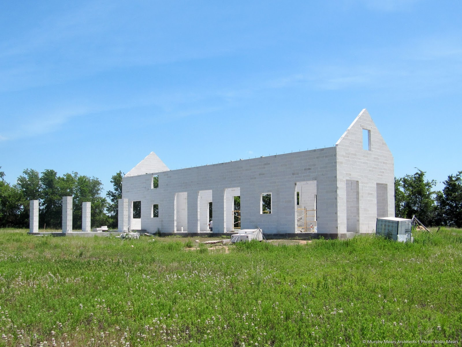 Modern farmhouse exterior under construction by Kirby Mears and Eleanor Cummings on Hello Lovely Studio