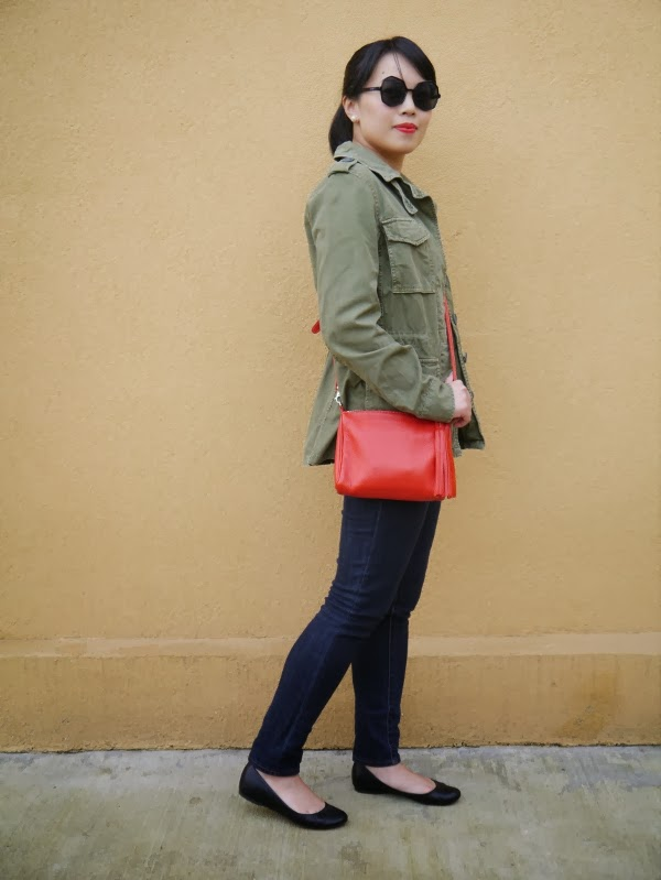 army jacket and red crossbody bag