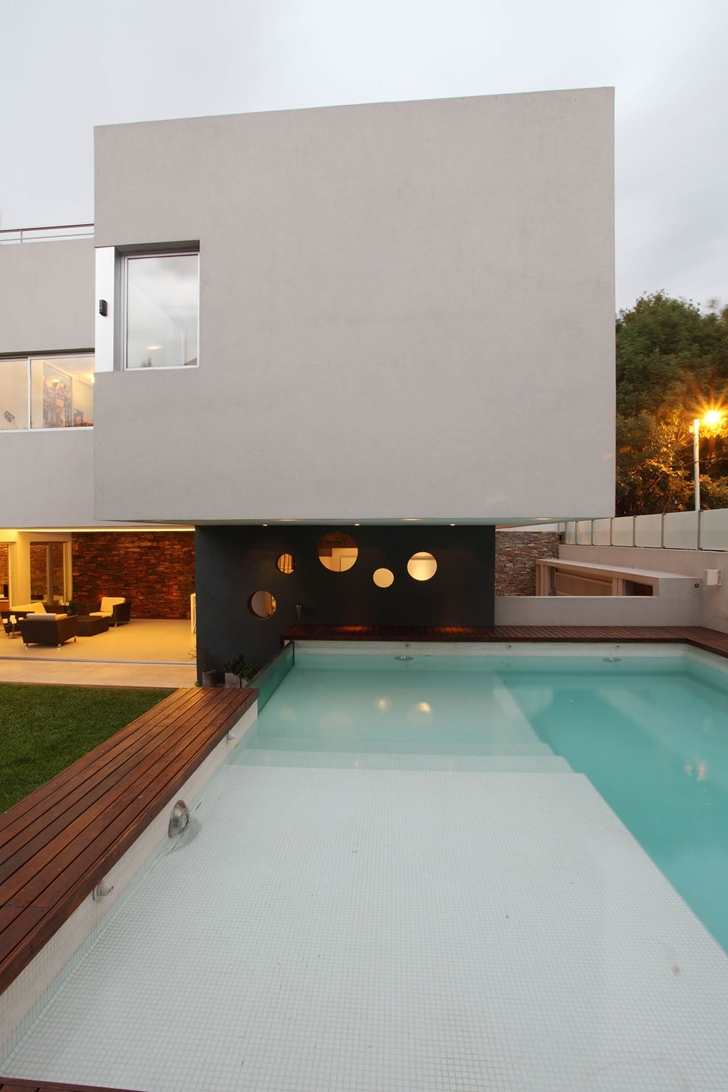 Pool by the house in Modern Villa Devoto by Andres Remy Architects