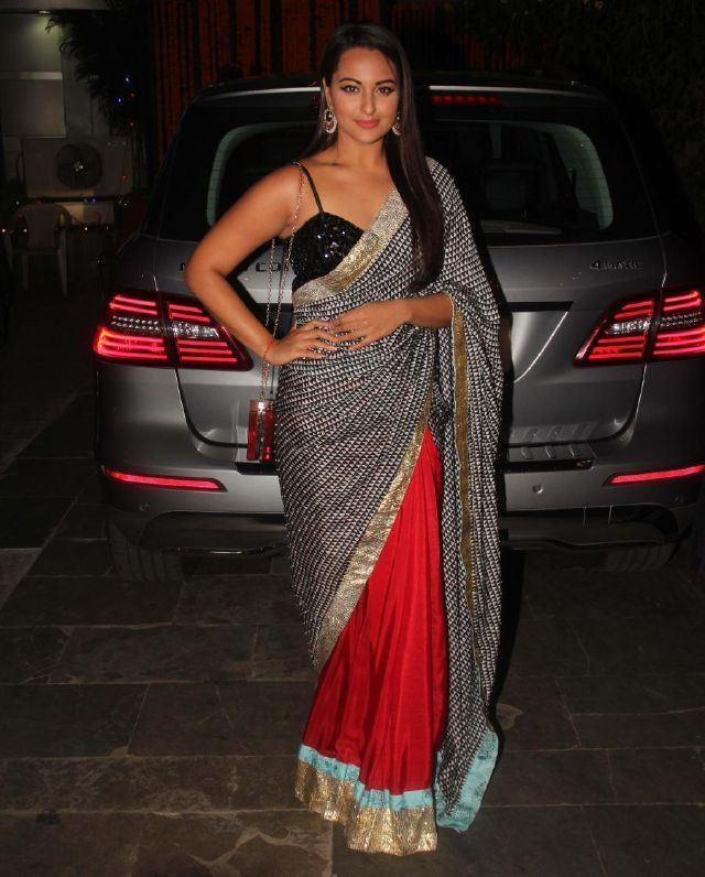 Indian actress sonakshi sinha stills in sleeveless red saree indian actress sonakshi sinha stills in sleeveless red saree thecheapjerseys Images