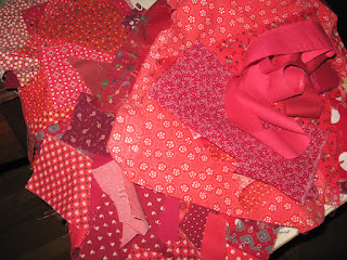 a pile of red fabric scraps