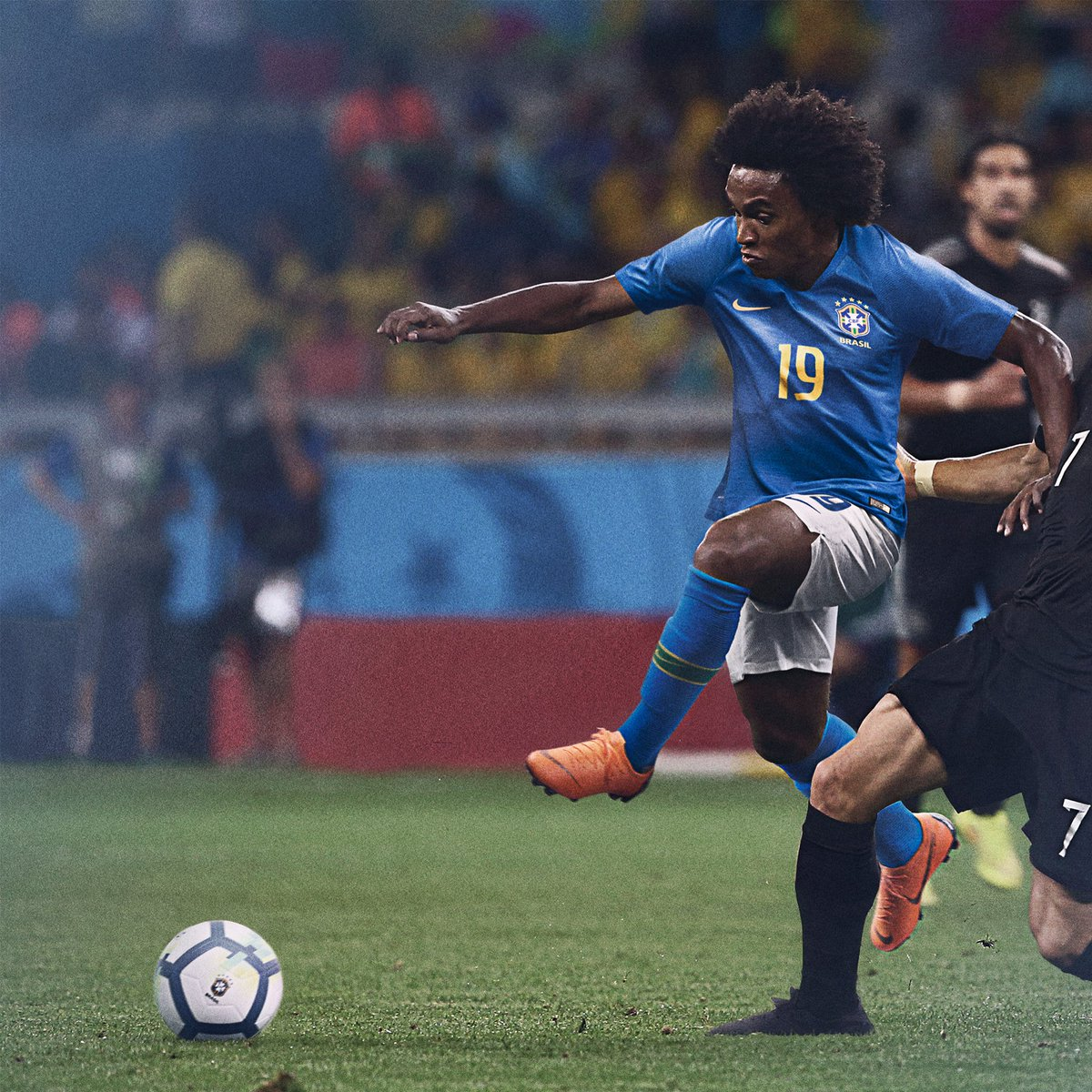 ... it appears that Nike have simply photoshopped and old photo of Chelsea  star Willian against Germany to promote the brand new World Cup Brazil Away  Kit.
