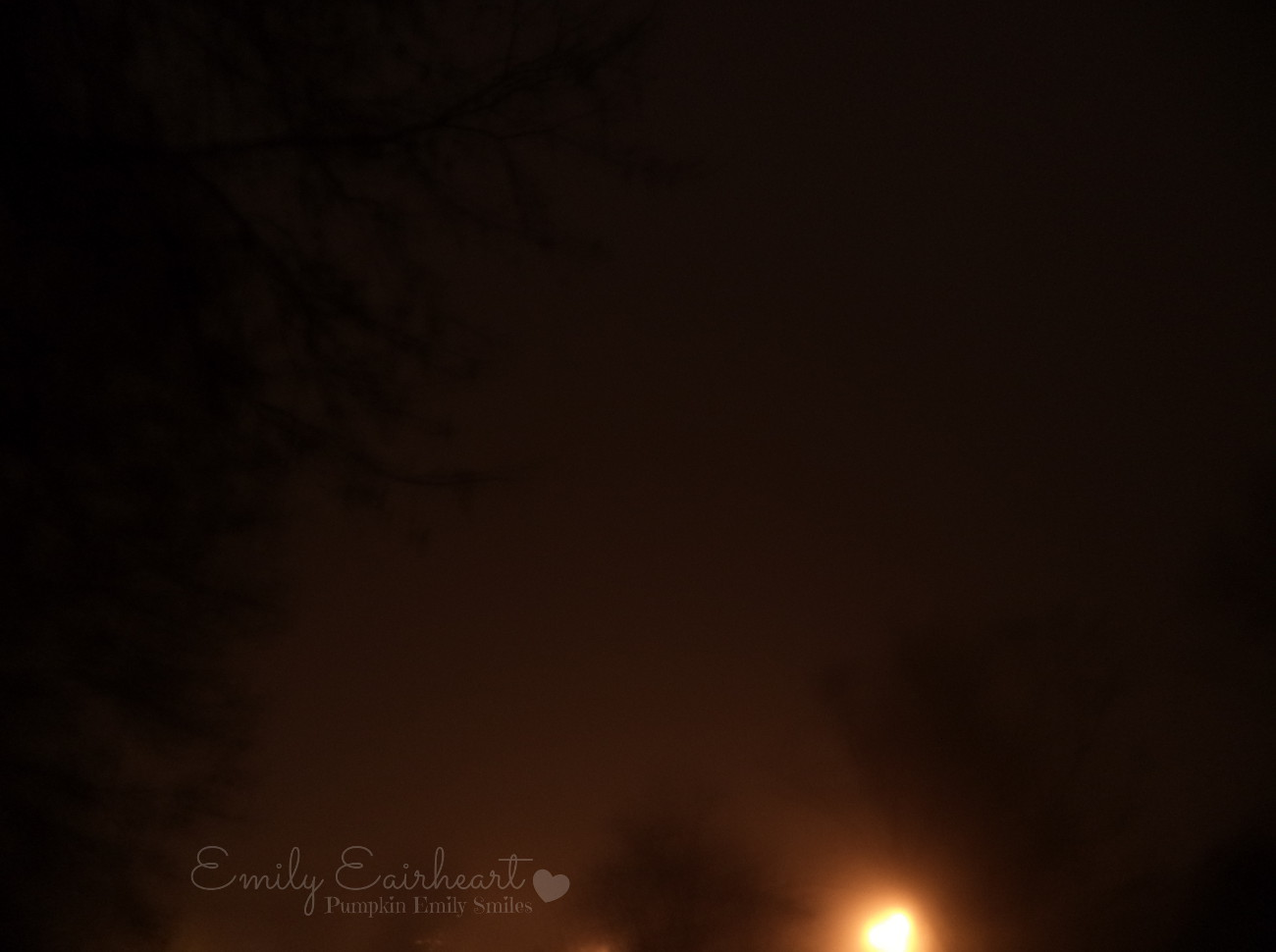Lights and sky surrounded by fog at night.