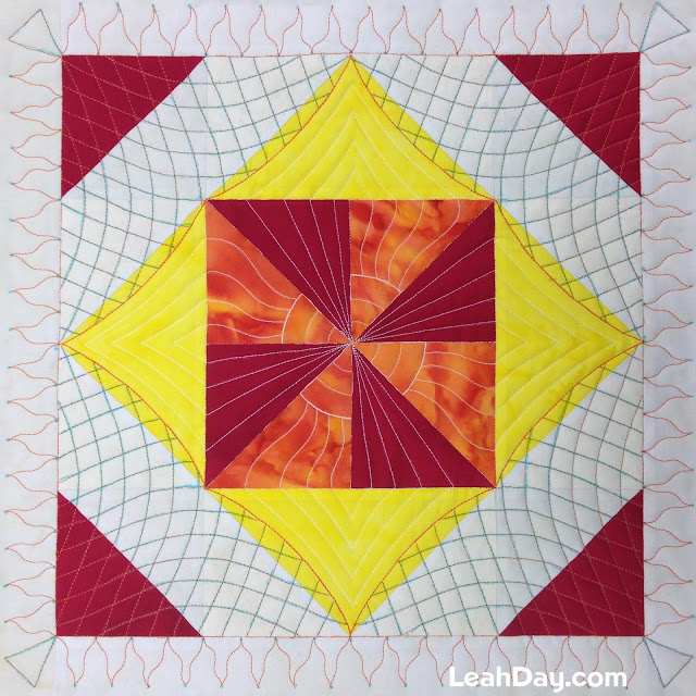 Learn how to machine quilt a Flaming Pinwheel Block with Leah Day
