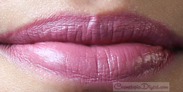 Swatches and review of NARS Audacious lipstick in Anna, a smoky medium dusty mauve that suits all skintones.
