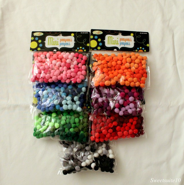 colourful bags of pompoms