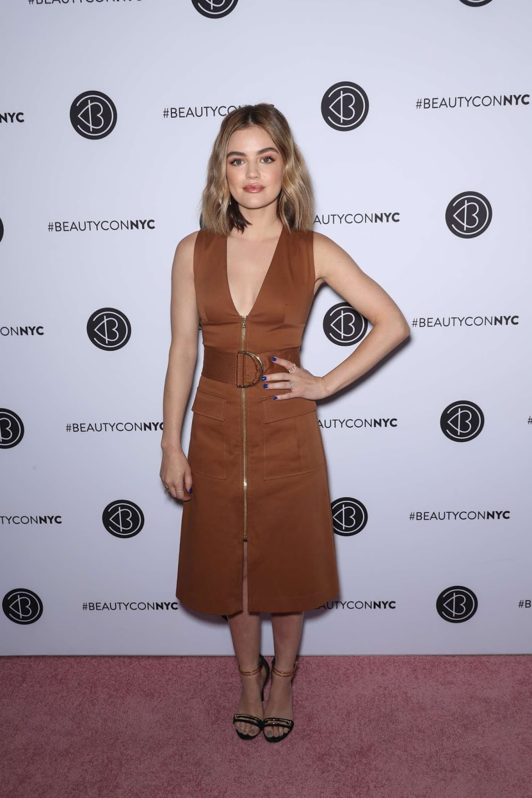 Lucy Hale flaunts cleavage at the BeautyCon Festival in NY