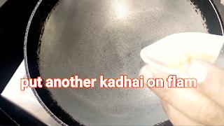 Image of kadhai on flame
