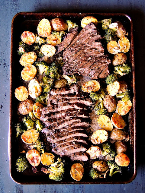 Sheet Pan Steak with Potatoes and Broccoli - Quick, and easy, with very little cleanup, this sheet pan dinner is one that your family will request again, and again! From www.bobbiskozykitchen.com