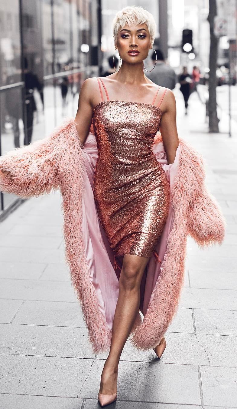 glitter fashion trends / blush fur coat and glitter dress