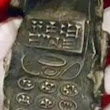 Did Archaeologists Discover an Ancient Alien Cell Phone?