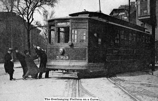 This staged safety photograph showed the 1914 public how a swivelling  streetcar could be dangerous when turning a corner
